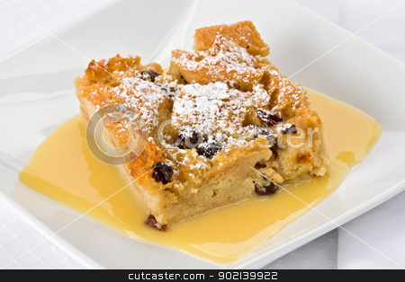Bread Pudding stock photo, Bread pudding with bourbon sauce on a square plate. by Glenn Price