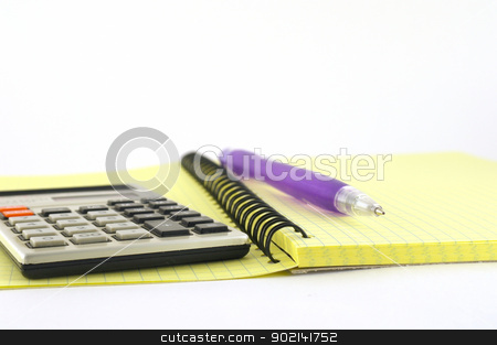 Calculator and pen on the yellow writing-book stock photo, Calculator and pen on the yellow writing-book. Shallow DOF. by Sergei Devyatkin