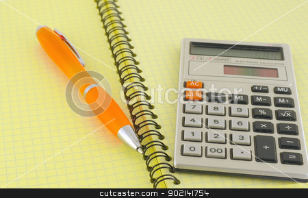 Old calculator and pen on the yellow writing-book stock photo, Old calculator and pen on the yellow writing-book by Sergei Devyatkin