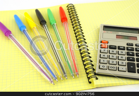 Old calculator and color pens on the yellow writing-book stock photo, Old calculator and color pens on the yellow writing-book by Sergei Devyatkin