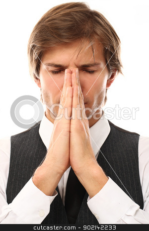 Handsome man in suit pray portrait stock photo, Handsome man in suit pray portrait over a white background by yekostock