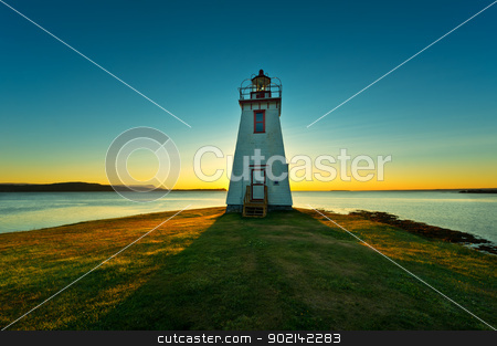 Lighthouse during sunrise  stock photo, Lighthouse during sunrise in the early morning with beautiful colors