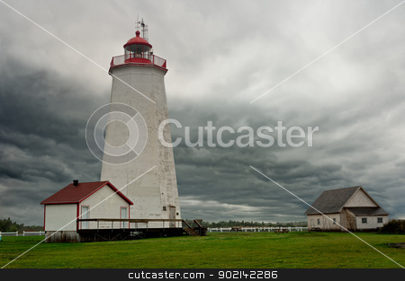 Miscou Lighthouse stock photo, Miscou Lighthouse, during a cloudy day, New Brunswick, Canadab by Ulrich Schade