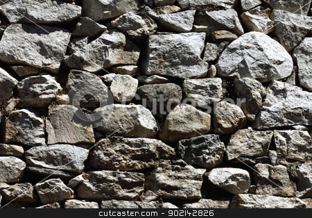 Natural pattern of a stone wall stock photo, Image of stone rock texture wall. background closeup by Sergey Nivens