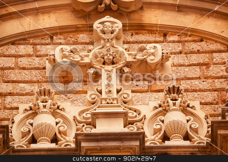 Cross Angel Statues Gothic Cloister Monestir Monastery of Montse stock photo, Christ Angel Statues Golthic Cloister Monestir Monastery of Montserrat, Barcelona, Catolonia, Spain.  Founded in the 9th Century, destroyed in 1811 when French invaded Spain. Rebuilt in 1844 and now a Benedictine Monastery.  Placa de Santa Maria by William Perry