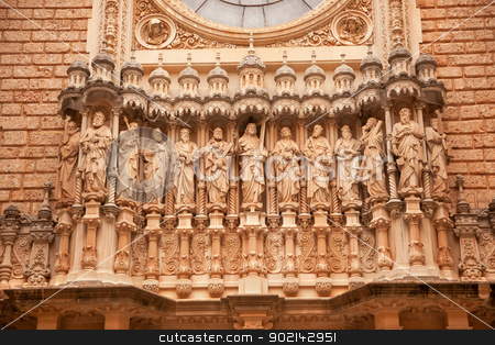 Christ Disciples Statues Facade Gothic Cloister Monestir Monaste stock photo, Christ Disciples Statues Facade Golthic Cloister Monestir Monastery of Montserrat, Barcelona, Catolonia, Spain.  Founded in the 9th Century, destroyed in 1811 when French invaded Spain. Rebuilt in 1844 and now a Benedictine Monastery.  Placa de Santa Maria by William Perry