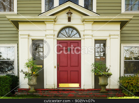 Magenta Door plants stock photo, Magenta Home door bordered by two large potted plants by bobkeenan