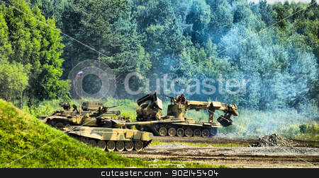 Military technic moving stock photo, Tank T-80, engineering vehicle moving through field and forest by Aikon