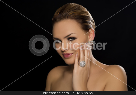 Beautiful woman with naked shoulders stock photo, Beautiful glamorous woman with naked shoulders and a lovely smile, head and shoulders portrait on a dark studio background with copy space by Instudio 68