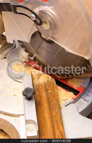 Electric Saw stock photo, electric saw cuts plank a plinth under corner 45 degrees. by Vladyslav Danilin