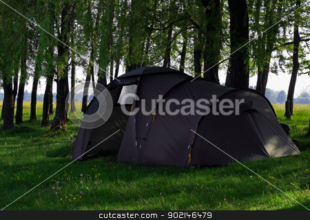 camping tent stock photo, Green camping tent on green grassbackground by Vladyslav Danilin