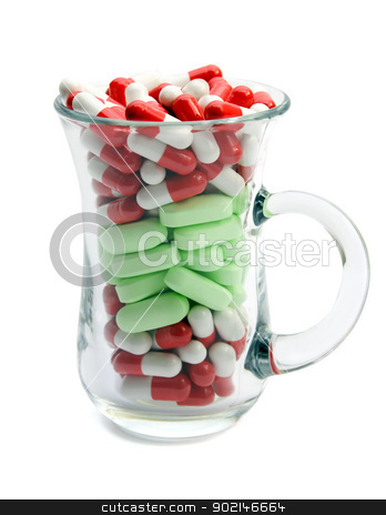 capsules stock photo, capsules and pills in cup glass isolated on white background by Vladyslav Danilin