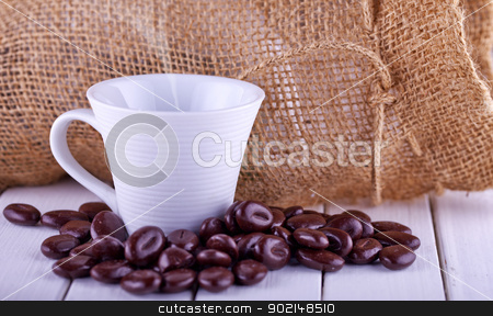 Coffee stock photo, Close up of a cup of coffee with coffee beans by Fabio Alcini