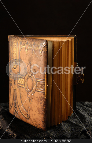 album 2 stock photo, old photo album on a dark background by Jolanta Rutkowska
