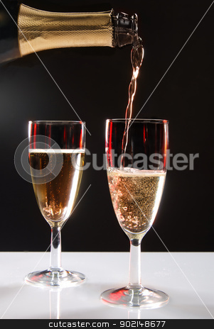 champagne stock photo, pouring champagneon a dark background by Jolanta Rutkowska
