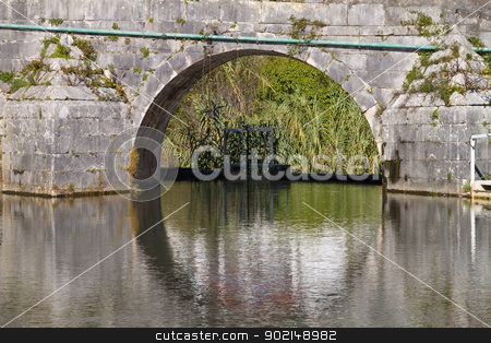 River Reflection  stock photo, River passage trough old stone wall, with reflection by Paulo M.F. Pires