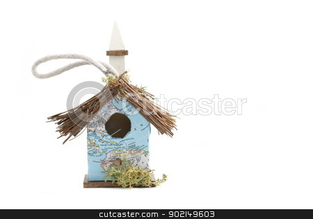 World Map Birdhouse stock photo, Very small  birdhouse with a map as wallpaper. by Henrik Lehnerer