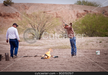 Movie Special Effects Worker Gesturing stock photo, Movie EFX worker gesturing over a small flame by Scott Griessel