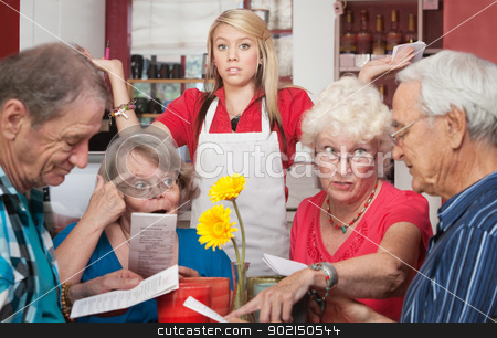 Patrons Argue About Menu stock photo, Annoyed waitress and group of patrons arguing about the menu by Scott Griessel