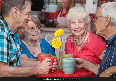 Happy Seniors at Restaurant stock photo, Group of four happy senior citizens at restaurant by Scott Griessel