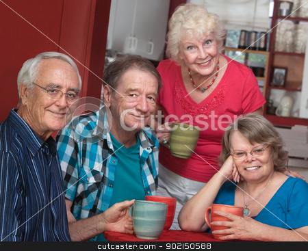 Four Smiling Friends in Bistro stock photo, Group of four joyful senior citizens in bistro by Scott Griessel
