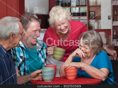 Laughing Friends in Coffeehouse stock photo, Group of laughing seniors in a coffeehouse by Scott Griessel