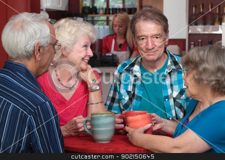 Older Adults in Conversation stock photo, Elderly white adults in a happy conversation at a cafe by Scott Griessel