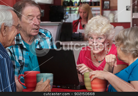 Elderly Woman with Friends and Laptop stock photo, Smiling senior woman with friends pointing at laptop in cafe by Scott Griessel