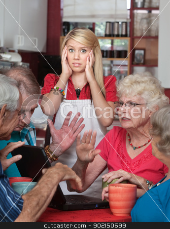 Bickering Seniors and Young Waitress stock photo, Bickering senior adults and young waitress in a cafe  by Scott Griessel
