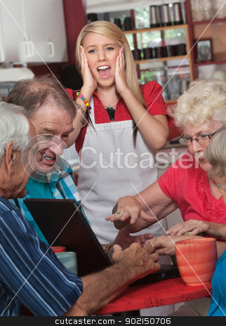 Screaming Watiress and Arguing Seniors stock photo, Screaming waitress with upset group of seniors on computer by Scott Griessel