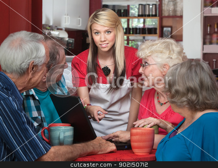 Seniors with Laptop and Helpful Waitress stock photo, Kind waitress helping elderly cafe customers with computer by Scott Griessel