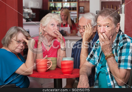 Embarrassed Seniors with Loud Friend stock photo, Loud mouth woman embarrassing group of friends in cafe by Scott Griessel