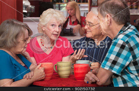 Pretty Senior Woman Talking with Friends stock photo, Pretty senior woman talking with friends in coffeehouse by Scott Griessel