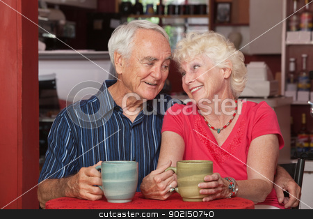 Cute Senior Couple in Love stock photo, Loving attractive senior couple sitting at table in cafe by Scott Griessel