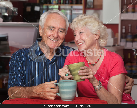 Adorable Older Couple in Bistro stock photo, Adorable older couple sitting together in a bistro by Scott Griessel