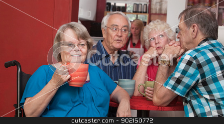 Friendly Woman in Wheelchair with Friends stock photo, Friendly senior woman in wheelchair and friends in coffeehouse by Scott Griessel