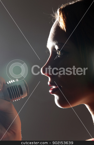 Portrait of female singer stock photo, Portrait of female rock singer with microphone by Sergey Nivens