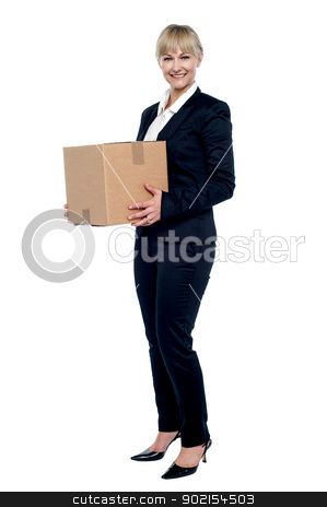 Female business executive relocating her office stock photo, Female business executive relocating her office, carrying cardboard box. by Ishay Botbol