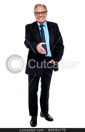 Joyous businessman extending his hand stock photo, Joyous businessman extending his hand, accept the deal. by Ishay Botbol
