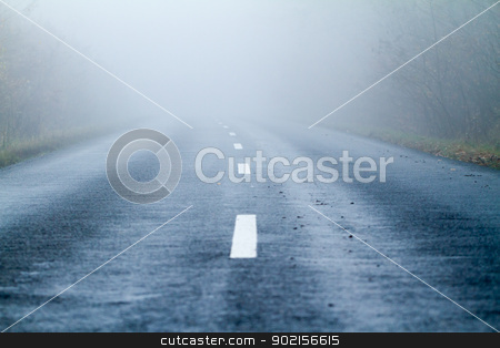 Asphalt road in an autumn fog stock photo, Asphalt road in an autumn fog by Jozsef Demeter