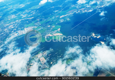 View at city through clouds stock photo, View above the earth at the clouds below by Aikon