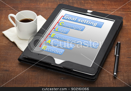 clear goal setting concept  stock photo, CLEAR (challenging, legal, environmentally sound, appropriate, recorded) goal setting concept - a diagram on a tablet computer with stylus pen and espresso coffee cup against grunge wooden table by Marek Uliasz