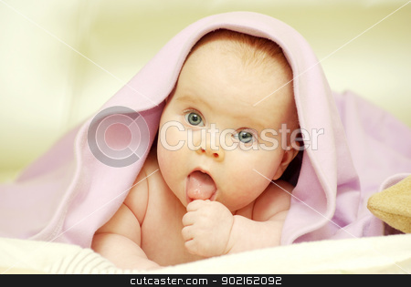 baby  stock photo, baby looking out from under blanket by Vitaliy Pakhnyushchyy