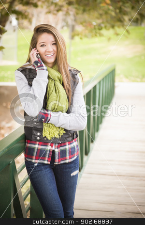 Mixed Race Attractive Woman Using Cell Phone stock photo, Attractive Mixed Race Attractive Woman Using Cell Phone Outside. by Andy Dean