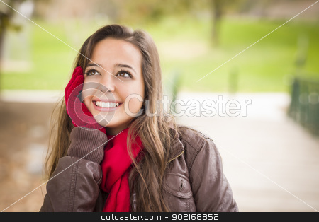 Pretty Woman Portrait Wearing Red Scarf and Mittens Outside stock photo, Pretty Festive Smiling Woman Portrait Wearing a Red Scarf and Mittens Outside. by Andy Dean