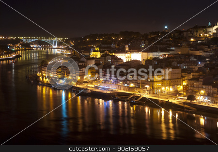 Porto at Night, Portugal stock photo, View to Porto over river Douro with reflection of the lights at night by dinozzaver