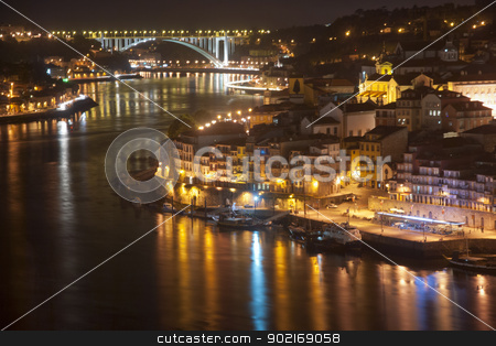 Porto at Night stock photo, View to Porto over river Douro with reflection of the lights at night, Portugal by dinozzaver
