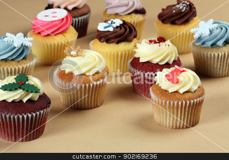 Festive cupcakes stock photo, Photo of many cupcakes decorated for Christmas. Focus across the middle.  by © Ron Sumners