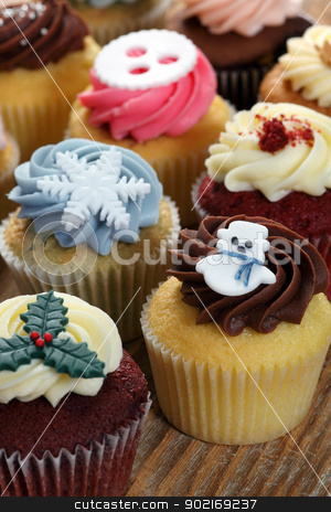 Christmas cupcakes stock photo, Photo of many cupcakes decorated for Christmas. Focus on snowman. by © Ron Sumners