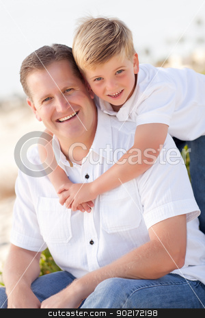 Cute Son with His Handsome Dad Portrait Outside stock photo, Cute Son with His Handsome Dad Portrait outside at the Beach. by Andy Dean